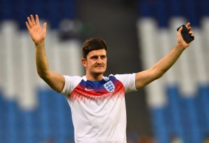 England's Harry Maguire salutes their fans after the match.