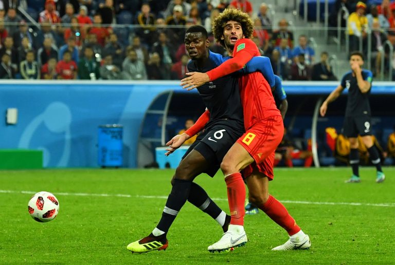 Belgium's Marouane Fellaini in action with France's Paul Pogba.