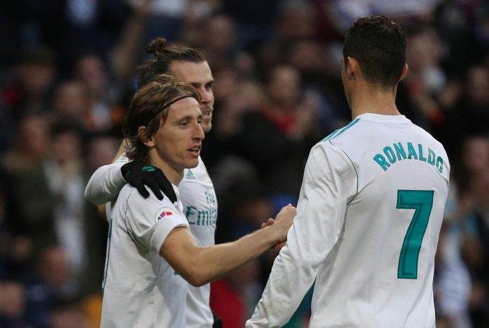 Real Madrid's Luka Modric celebrates scoring their fourth goal with Gareth Bale and Cristiano Ronaldo.