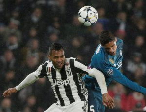 Real Madrid's Raphael Varane in action with Juventus' Alex Sandro.