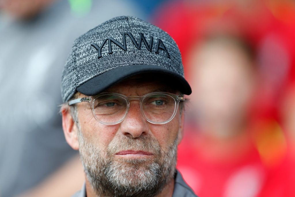 Liverpool manager Jurgen Klopp looks on.