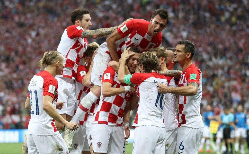 Croatia's Ivan Perisic celebrates scoring their first goal with team mates.
