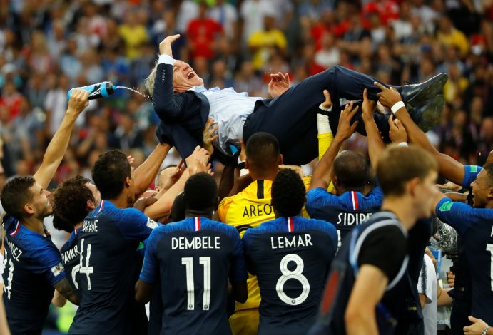 France coach Didier Deschamps is thrown into the air by his players as they celebrate after winning the World Cup.
