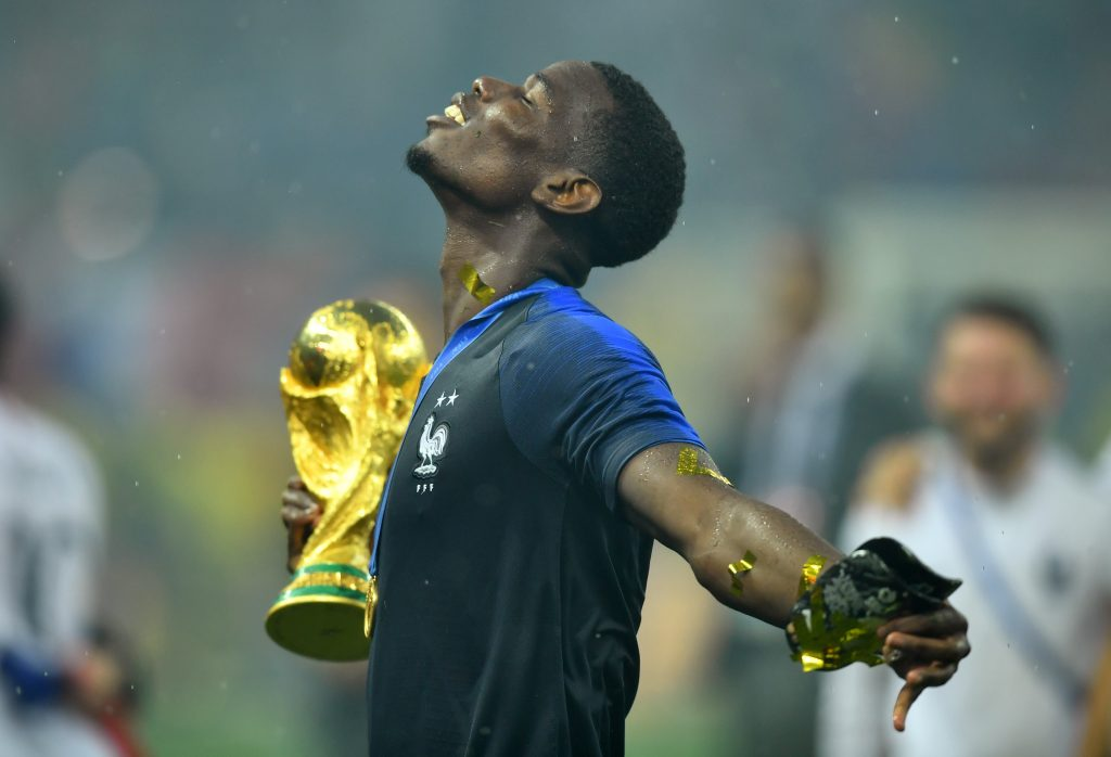 Soccer Football - World Cup - Final - France v Croatia - Luzhniki Stadium, Moscow, Russia - July 15, 2018  France's Paul Pogba holds the trophy as he celebrates winning the World Cup  REUTERS/Dylan Martinez - RC1208D9DF10