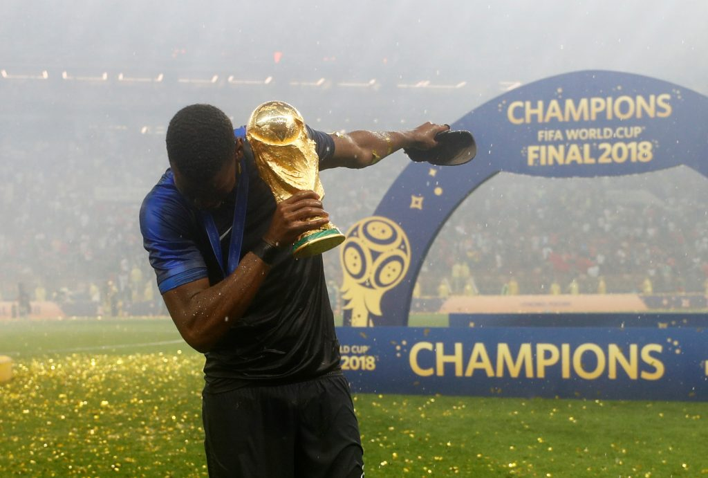 Soccer Football - World Cup - Final - France v Croatia - Luzhniki Stadium, Moscow, Russia - July 15, 2018  France's Paul Pogba celebrates with the trophy after winning the World Cup  REUTERS/Kai Pfaffenbach - RC12A644DB60