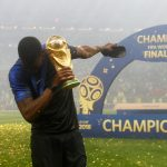 France's Paul Pogba celebrates with the trophy after winning the World Cup.