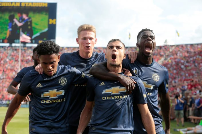 Manchester United's Andreas Pereira celebrates scoring their first goal with team mates.