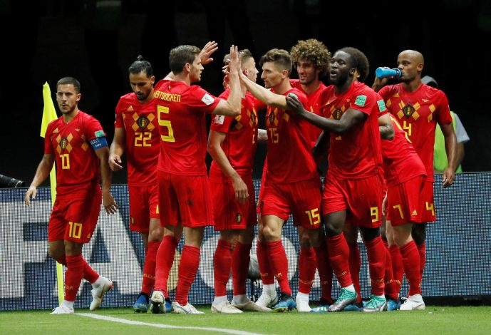 Belgium players celebrate after Kevin De Bruyne scores their second goal.