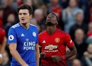 Leicester City's Harry Maguire and Manchester United's Paul Pogba.