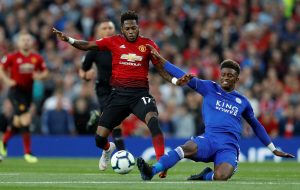 Leicester City's Demarai Gray in action with Manchester United's Fred.