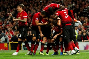 Manchester United's Luke Shaw celebrates scoring their second goal with team mates.
