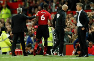 Manchester United's Paul Pogba with Manchester United manager Jose Mourinho after being substituted.