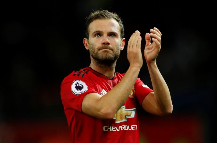 Manchester United's Juan Mata applauds fans after the match.