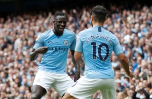 Man City's Sergio Aguero celebrates scoring their third goal with Benjamin Mendy.