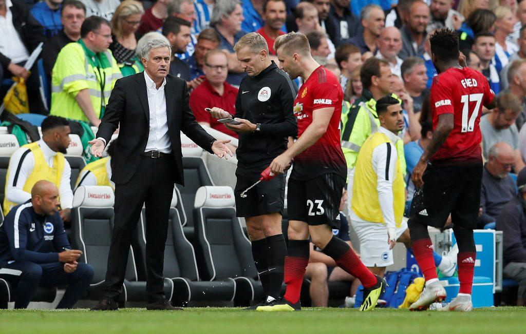 Manchester United manager Jose Mourinho speaks with Luke Shaw.