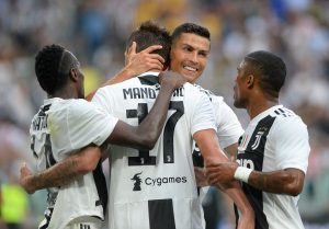Juventus' Mario Mandzukic celebrates scoring their second goal with Cristiano Ronaldo and team mates.