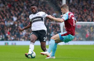 Fulham's Timothy Fosu-Mensah in action with Burnley's Johann Berg Gudmundsson.