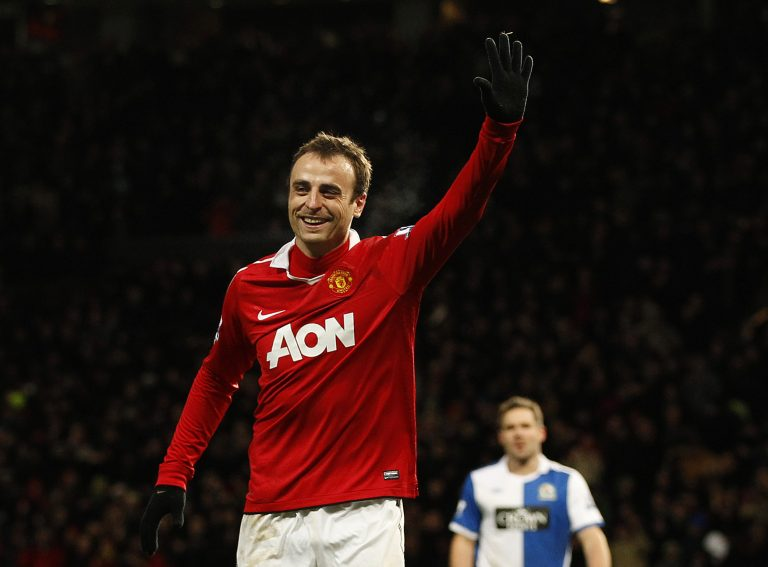 Dimitar Berbatov celebrates scoring the seventh goal for Manchester United.