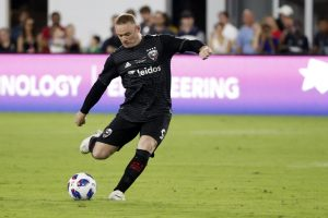 D.C. United forward Wayne Rooney (9) kicks a free kick against the Vancouver Whitecaps at Audi Field.