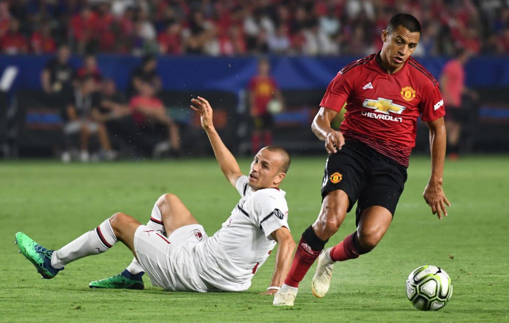 Alexis Sanchez (7) moves the ball away from Milan defender Luca Antonelli (31) in the second half during an International Champions Cup soccer match.