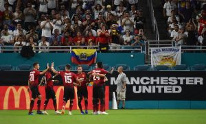 Manchester United teammates celebrate the goal of forward Alexis Sanchez (7) against Real Madrid during the first half of an International Champions Cup soccer match.