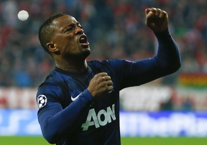 Patrice Evra celebrates after scoring a goal against Bayern Munich.
