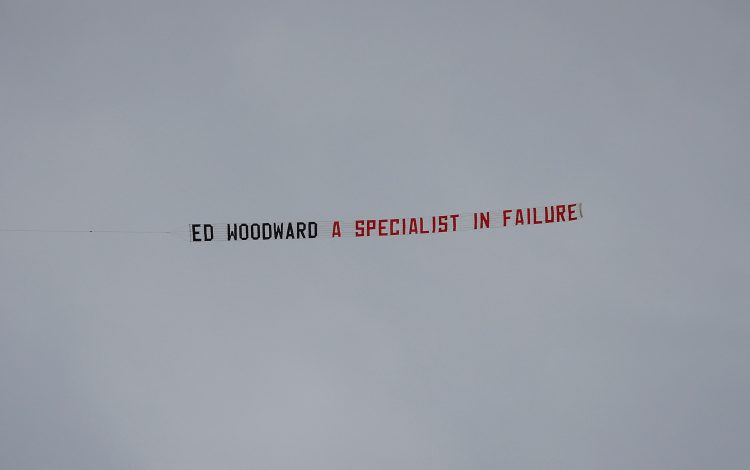 Plane banner referencing Manchester United chief executive Ed Woodward flown over the stadium before the match.