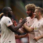 Manchester United's Romelu Lukaku celebrates scoring their first goal with Luke Shaw.