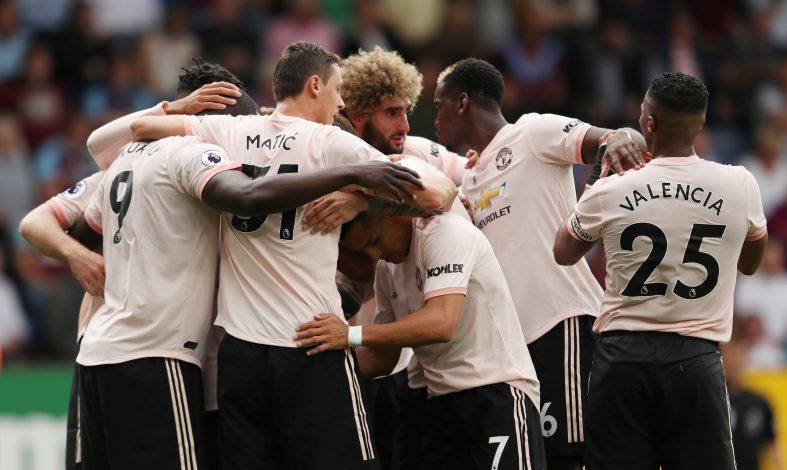 Manchester United's Romelu Lukaku celebrates scoring their second goal with teammates.