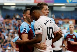 Burnley's Phil Bardsley clashes with Manchester United's Marcus Rashford.
