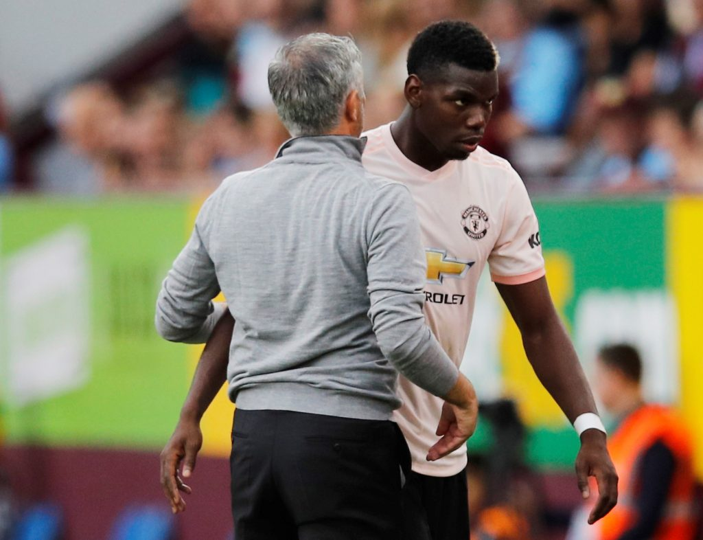 Manchester United's Paul Pogba with manager Jose Mourinho after being substituted off.