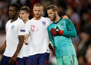 England's Eric Dier talks to Spain's David De Gea.