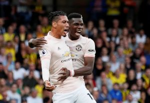 Manchester United's Chris Smalling celebrates scoring their second goal with Paul Pogba.