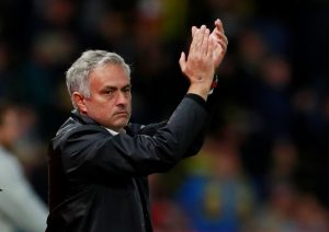Man Utd manager Jose Mourinho applauds fans after the match.
