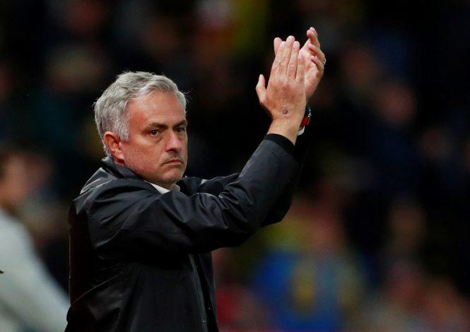 Man Utd manager Jose Mourinho applauds fans after the match.