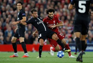 PSG's Juan Bernat in action with Liverpool's Mohamed Salah.