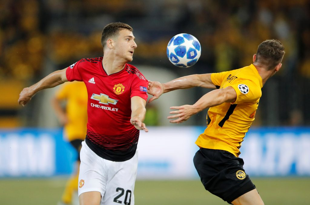 Manchester United's Diogo Dalot in action with Young Boys' Christian Fassnacht.