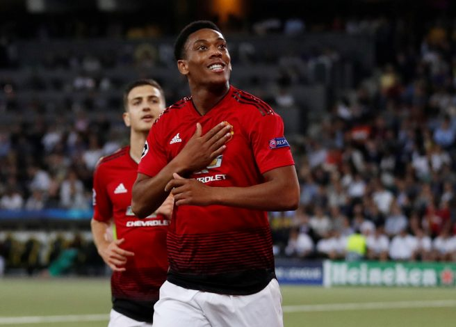 Manchester United's Anthony Martial celebrates scoring their third goal.