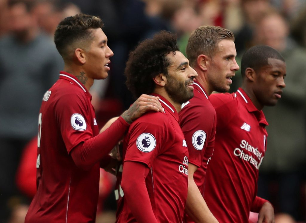 Liverpool's Mohamed Salah celebrates scoring their third goal with teammates.