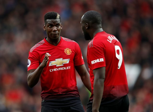 Manchester United's Paul Pogba speaks with Romelu Lukaku.