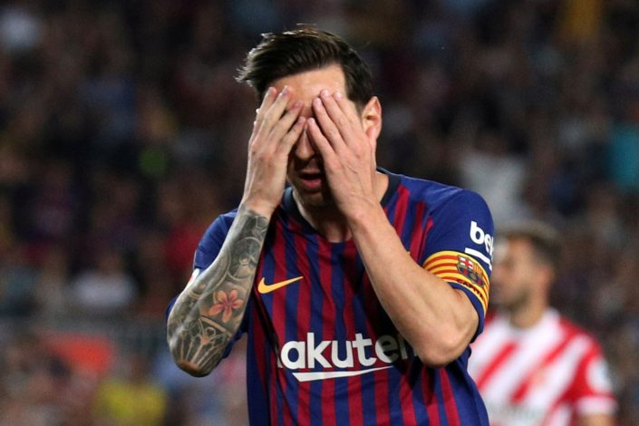 Barcelona's Lionel Messi reacts.