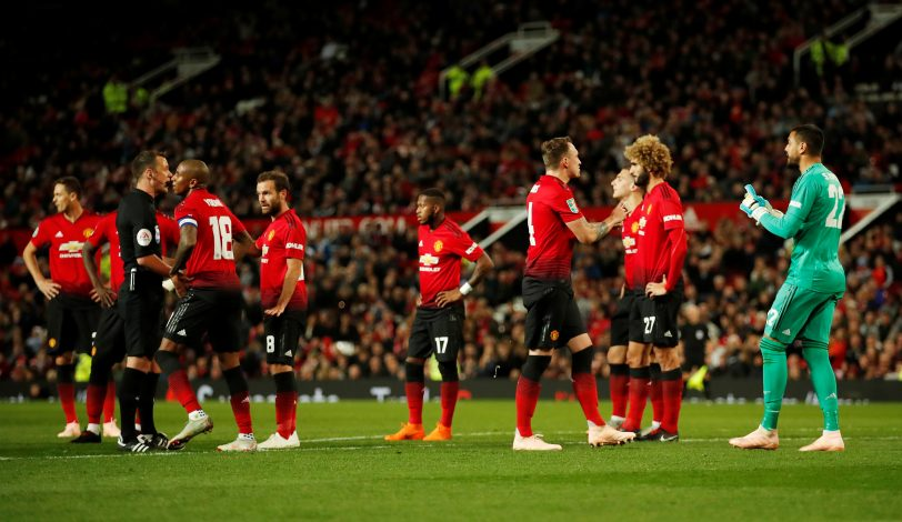 Man Utd players react after Sergio Romero is shown a red card.