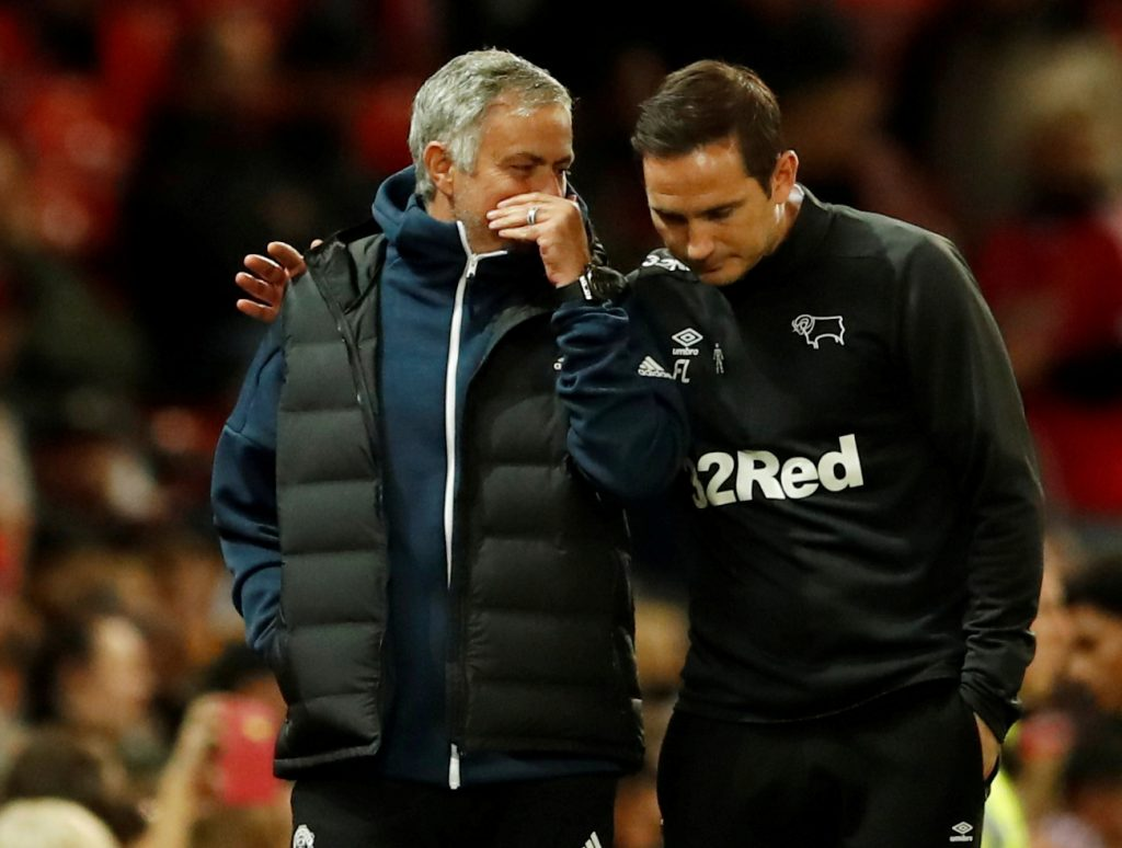 Jose Mourinho speaks with Derby County manager Frank Lampard.