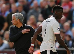 Paul Pogba with manager Jose Mourinho after being substituted off.