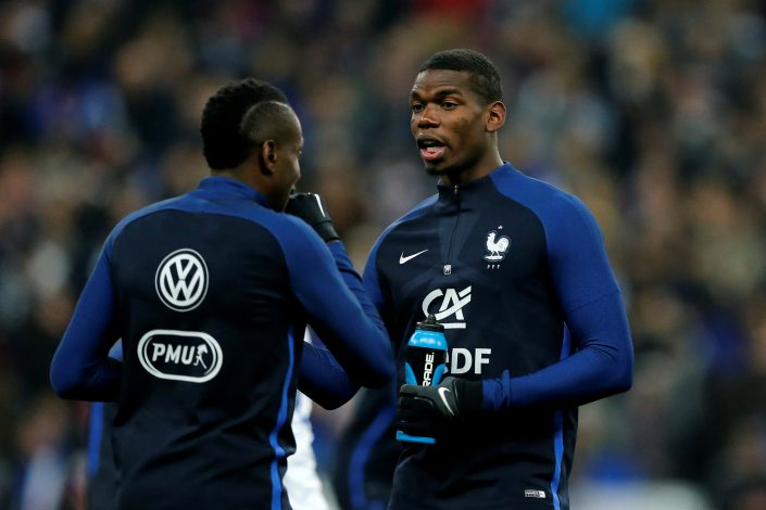 France's Blaise Matuidi (L) and Paul Pogba warm up before the match.