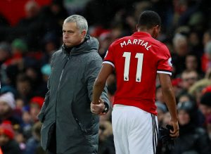 Manchester United's Anthony Martial walks past manager Jose Mourinho as he is substituted.