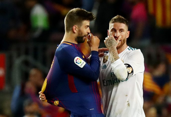 Barcelona's Gerard Pique talks with Real Madrid's Sergio Ramos at the end of the match.