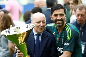 Juventus' Gianluigi Buffon celebrates winning the league with Juventus CEO Giuseppe Marotta and the trophy.