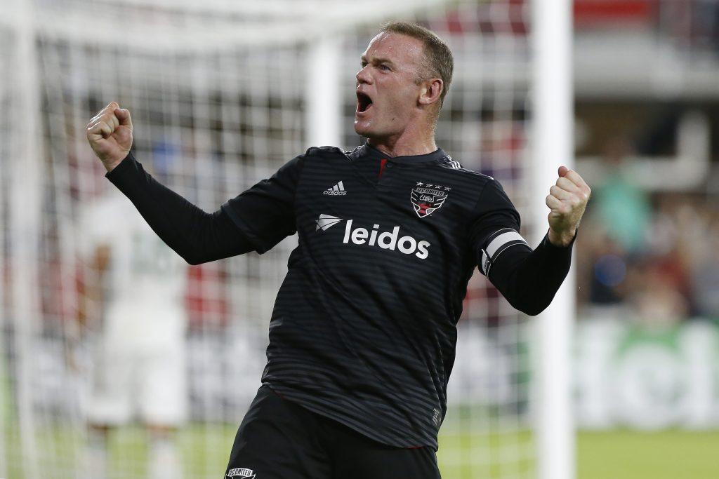 DC United striker Wayne Rooney (9) celebrates after scoring a goal.