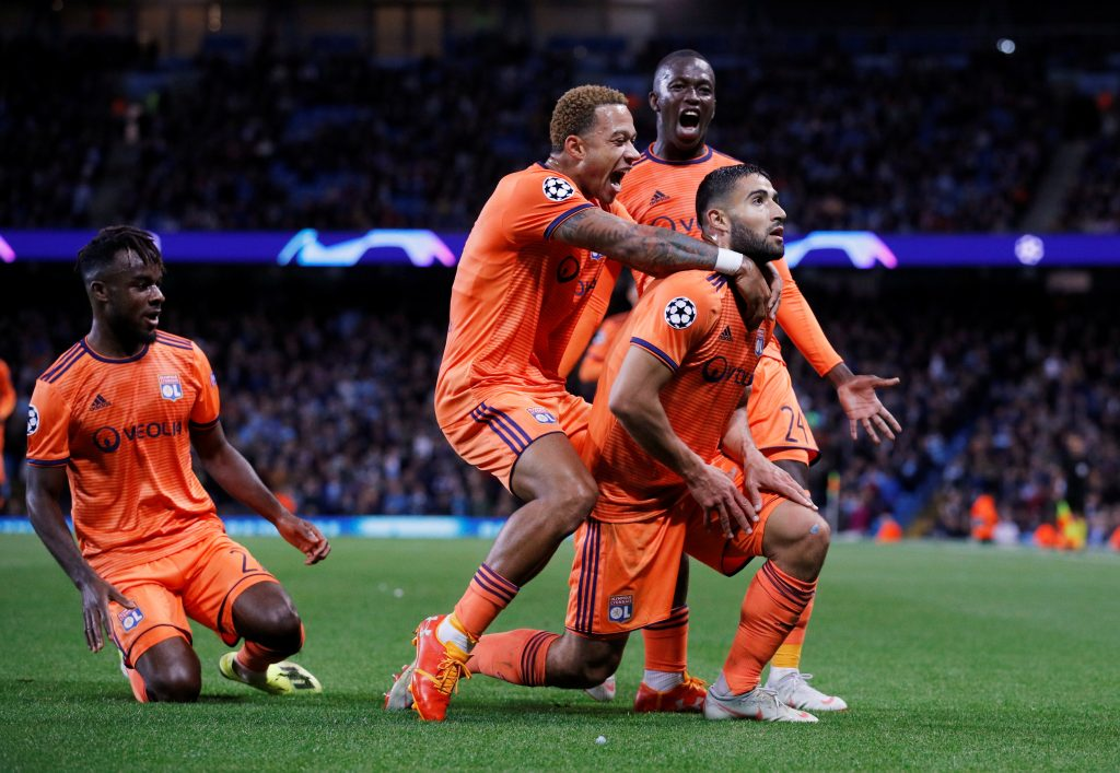 Lyon's Nabil Fekir celebrates scoring their second goal with teammates.